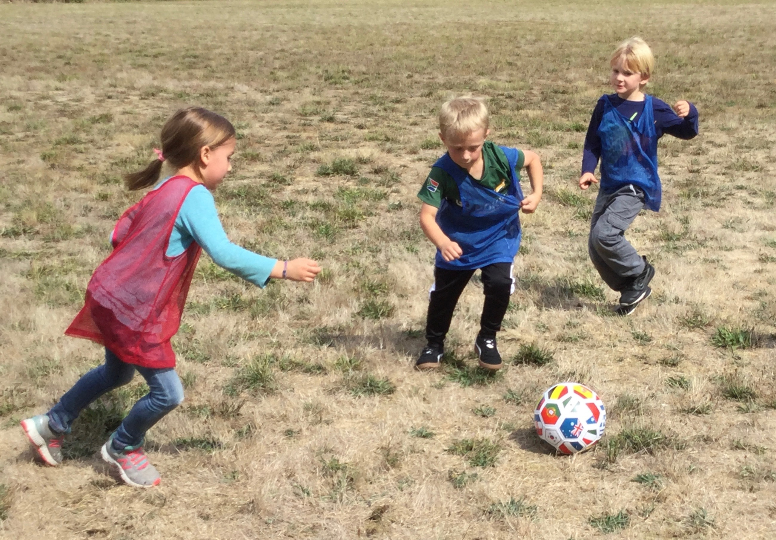 Children playing with a soccer ball